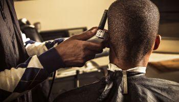 Man having haircut at barber shop