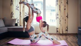 Mother Teaches Her Daughter To Practice Yoga