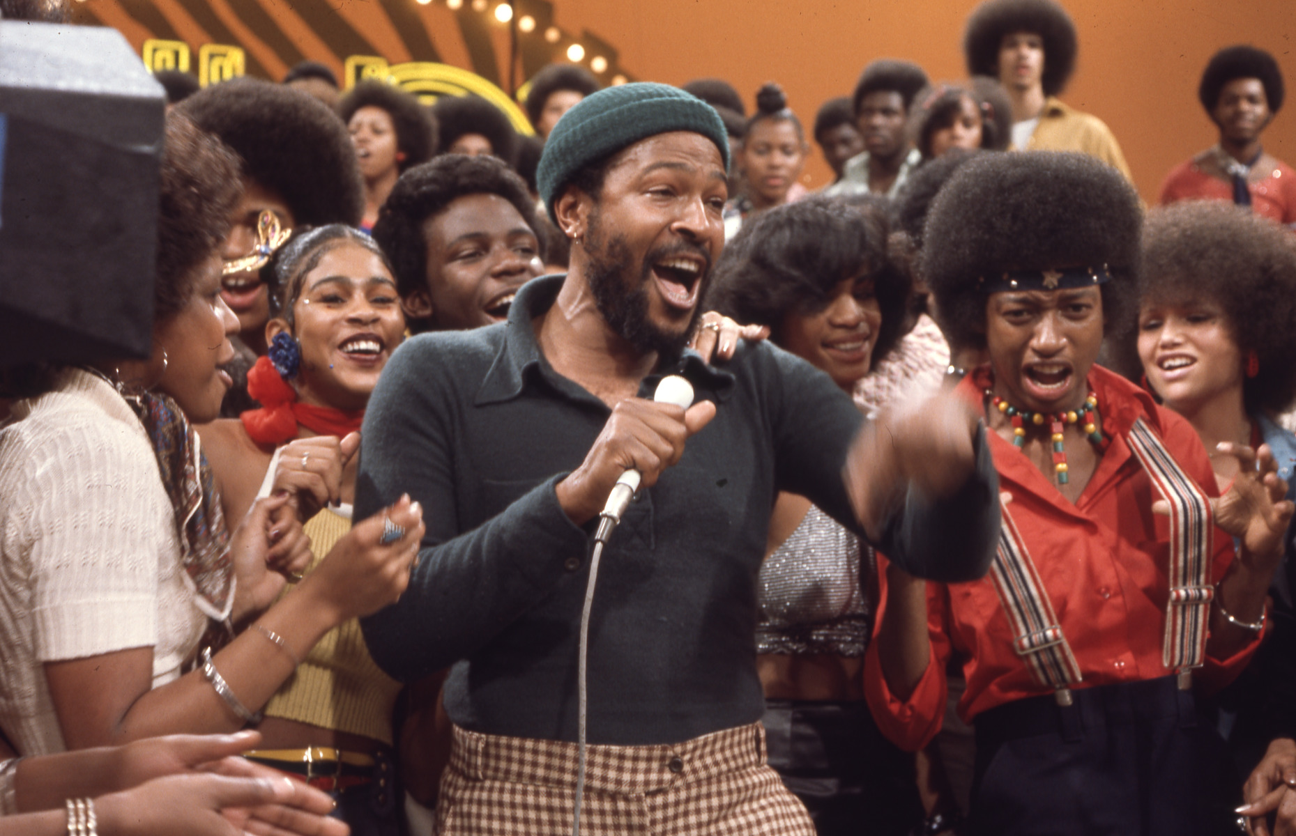 Marvin Gaye performs on Soul Train surrounded by dancers James Phillips and Fawn Quinones