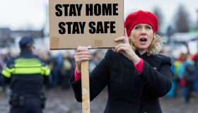 Beautiful blonde woman protester during Covid-19 crisis