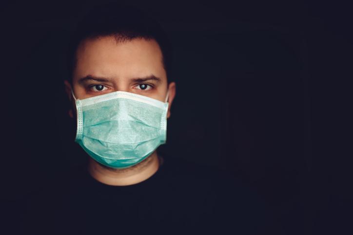 Man Wearing Medical Surgical Face Mask